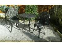 Heavy cast iron garden table and 2 chairs