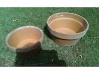 2 round clay garden pots
