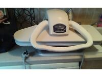 Steam press, excellent for all clothing and bedding, easy to use. Takes the stress from ironing.