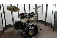 Retired Drum teacher has a Pearl Export drum kit with a choice of cymbals for sale.