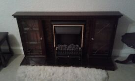 Wooden fire surround with electric fire.