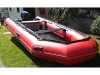 Inflatable boat and engine