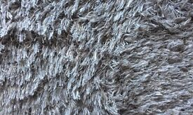 Small dark beige rug