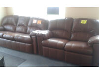 2 LEATHER SETTEES , ELECTRIC RECLINE. Very Good Condition.. Local Delivery....