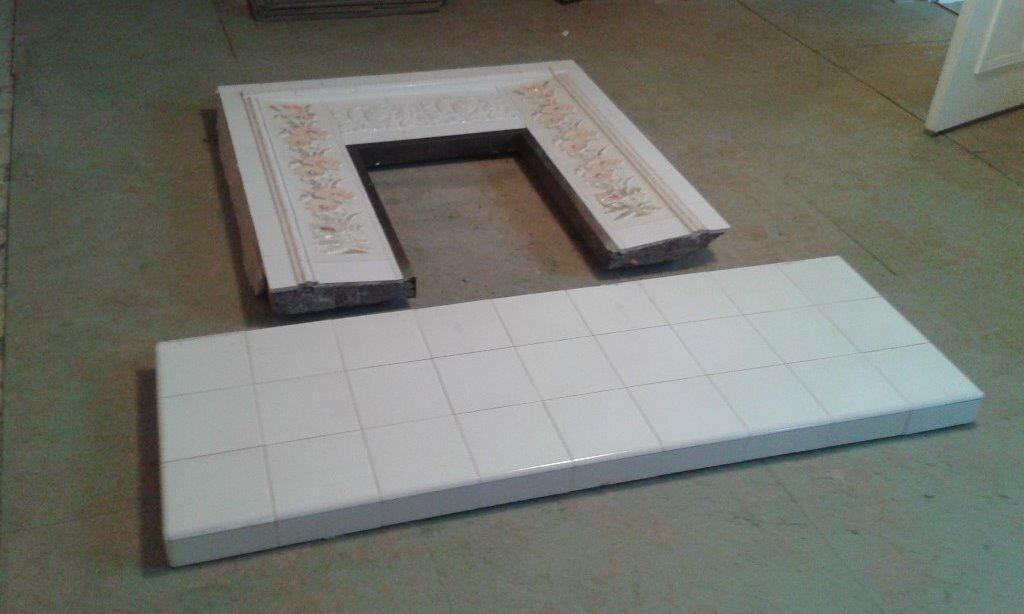 Decorative tiled fire surround with hearth for sale