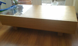 stylish wood and glass coffee table with hidden storage.