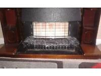 excellent condition gas fire with a fireplace.