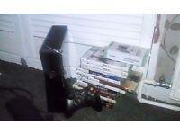 Xbox 360 slim 250gb comes wiv 13 games