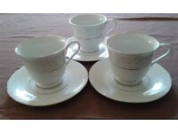 Vintage bone china tea set, 3 cups and saucers, with silver and blue flowers