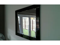For sale Glass Wall Mirror with Black Mirror Surround