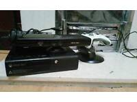 Xbox 360 E with Kinect, controller charger and 18 games.