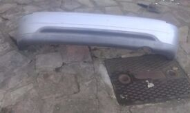 nissan micra 1999 , rear bumper,complete with the iron,finished in silver,