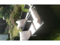 Ratten effect garden chairs with seat pads and cushions .