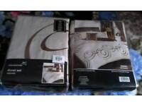 Brand new 2 king bed sets same with 1 duvet cover, 2 pillow cases, curtains in each set, 10 peices