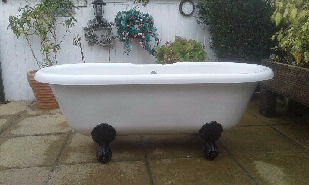 Freestanding roll top bath with cast-iron ball and claw feet..SOLD SORRY !!!!!!