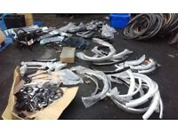 New job lot of bike parts mudguards skirt guards crank pedals brakes tyre inserts bottle cages pump