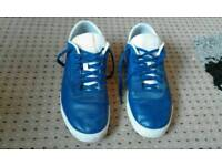 Blue and white leather reebok trainers