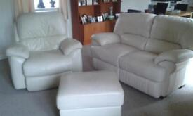 Ivory two seater leather sofa and matching recliner armchair and storage pouffe