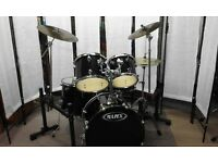 Retired Drum teacher has a Mapex drum kit with a choice of cymbals for sale.