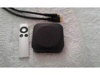 Apple TV box, remote control and hdmi cable