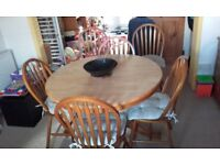 Pine Pedestal Dining Table and 6 matching Chairs, extendable from round to oval