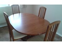 Lovely extending table with four upholstered seat chairs. £80 o.n.o.