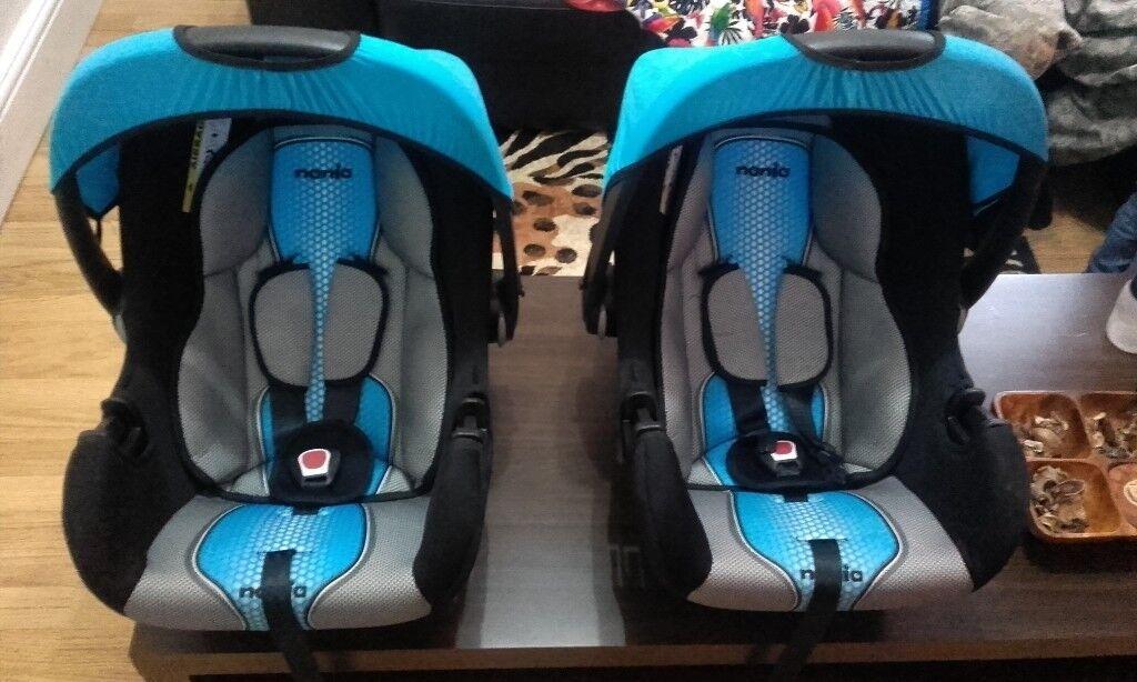 Two 0+ Nania blue/black/grey twin car seat