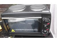 Table top electric oven and hob unused. Good for camping. Students. Etc