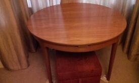 Nathan 4ft round table extends to a 6ft oval with three chairs