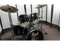Retired drum teacher has several mid range drum kits with upgraded cymbals for sale from £350.