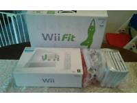 Nintendo Wii console ,fit board, games , and attachments