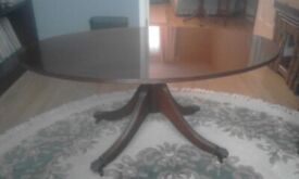 Oval table, coffee/occasional table. Dark wood. Finely crafted. Vintage, retro, traditional