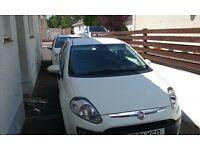White Fiat punto 2011 plate