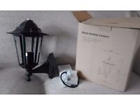 Black Outdoor Lantern Approx 215mm wide x 321mm high. Aluminimum body - 230 v. Still in box