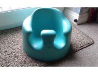 Bumbo seat in aqua. Excellent condition in original box