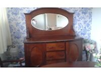 Vintage sideboard with oval mirror
