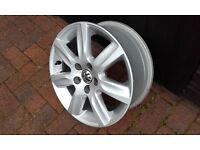 """VW 15"""" 7-spoke alloy wheel."""