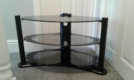 TV STAND, smoked dark glass, excellent condition, as new.