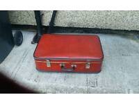 1950s red suitcase