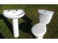 White bathroom toilet and basin.