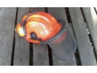 Forestry chainsaw, strimming helmet with visor and ear defenders