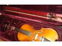 A beautiful refurbished violin along with it's own case.