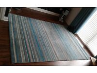 Teal/grey/white stripe carpet.