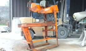 stone clipper saw on stand.