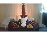 CHOCOLATE FOUNTAIN £100. 50p CHAIR COVER. CANDELABRA WITH CANDLES £8
