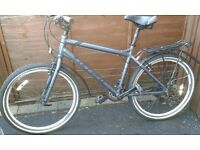 """Mens hybrid 18"""" Carrera Subway bike for sale. Pucture prof tyres, 21speed, pannier rack, mudguards"""