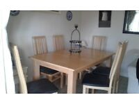 Extendable Dining Table and 6 Chairs with black seat covers. Collection only.