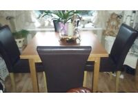 OAK DINNING TABLE AND 6 CHAIRS (ALMOST NEW)