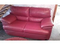 Red Italian leather 2 seater sofa call or text if intrested no time wasters