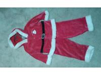 Baby's Father Christmas out 9-12 months